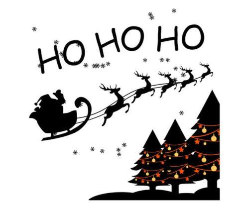 サンタクロースがソリで笑いながら空を飛ぶ