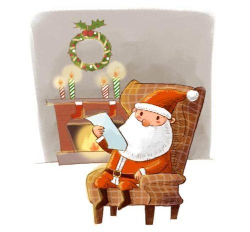 暖炉の前で手紙を読むサンタクロース
